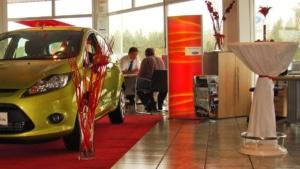 Freestanding totem lightbox in Ford car showroom