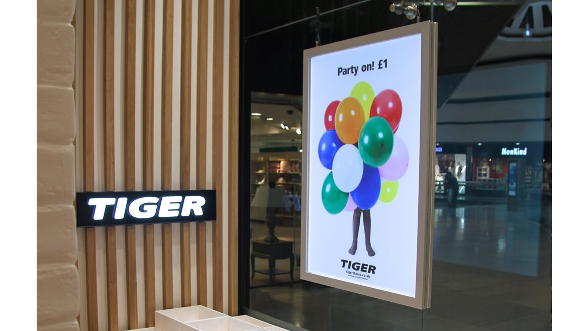 Tiger stores tension fabric lightbox instore