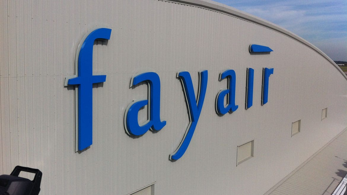 Aviation industry - Fayair aircraft hangar signage at Stansted airport